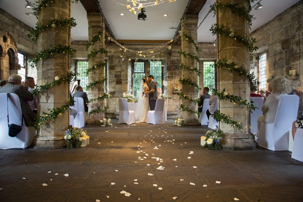 first kiss as husband and wife at hospitium wedding