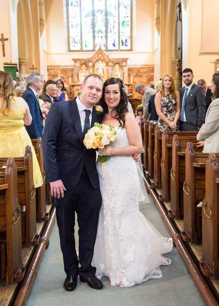 couple walking back up the aisle as husband and wife