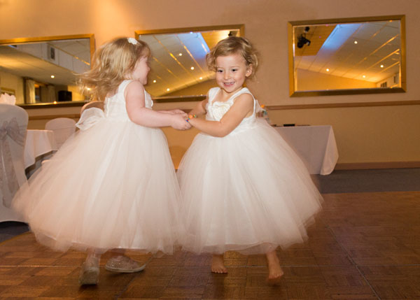 flowergirls in white dresses dancing