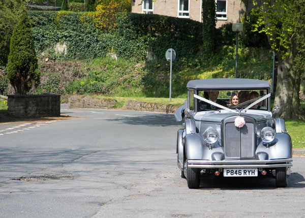 bride arriving at venue in wedding car