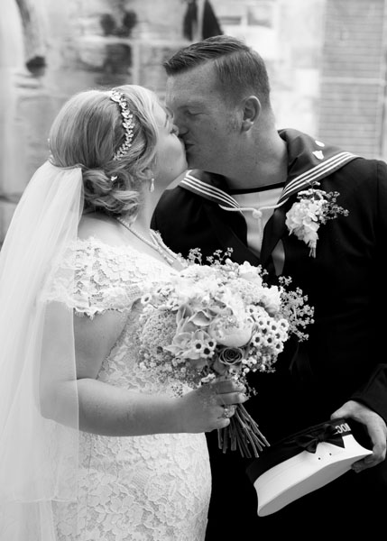 black and white church wedding first kiss
