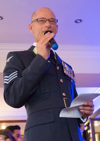 man in uniform giving a speech during the wedding breakfast