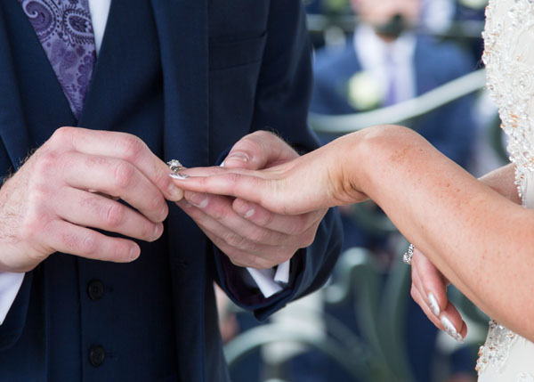 close up of ring exchange during the wedding ceremony