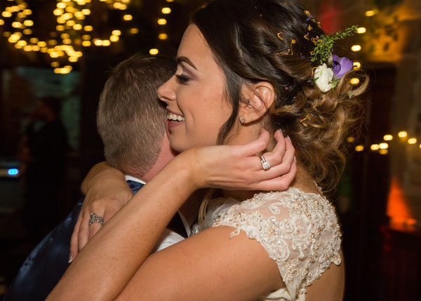 close up of first dance bride brushing hair behind her ear