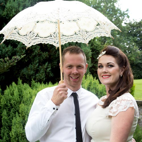 bridesmaid with her partner and parasol barnsley photographer