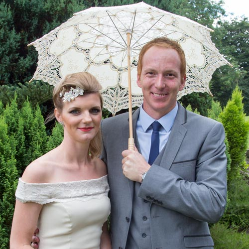 bridesmaid with her partner and parasol vintage hair
