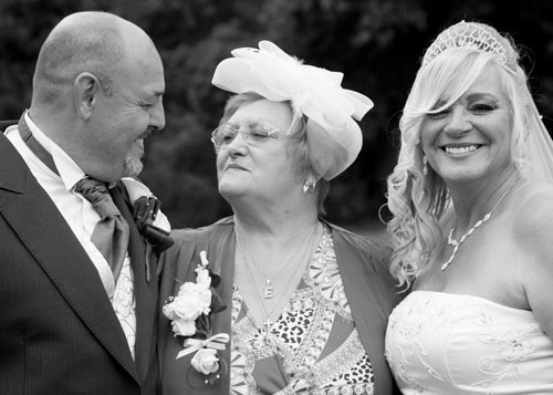 Bride and groom with Mother after the ceremony clifton park rotherham black and white photograph