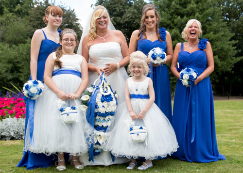 Bridal party laughing in clifton park wearing blue and white dresses
