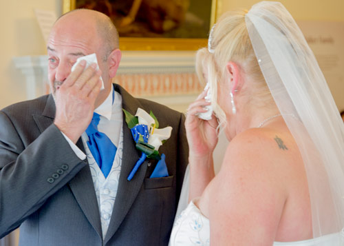 Bride and groom both crying during their wedding ceremony at clifton park museum rotherham