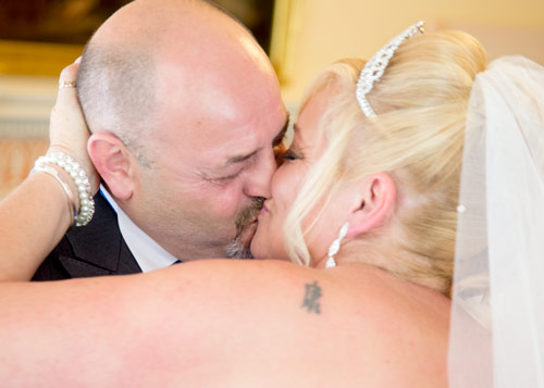 Kissing the bride after the wedding ceremony in clifton park museum