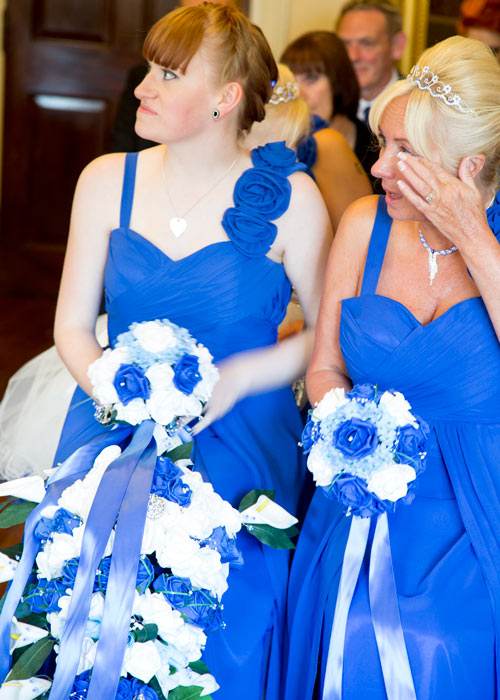 Bridesmaids watching wedding ceremony tearfully in blue dresses with blue and white bouquets clifton park museum rotherham