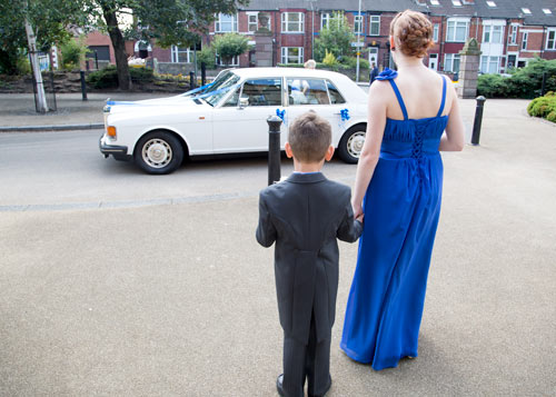Bridesmaid and pageboy waiting for bride to arrive at clifton park museum rotherham