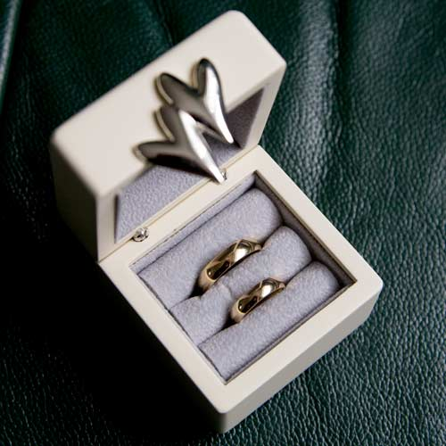 Wedding rings presented in a ring box in the grooms house before they are worn