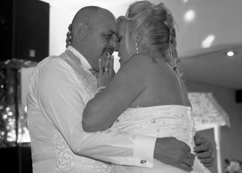 first dance black aand white photograph bride touching grooms face