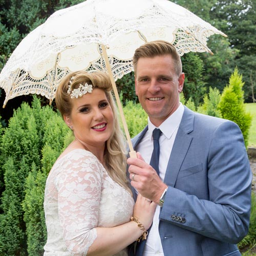 Maid of honor with her husband and parasol