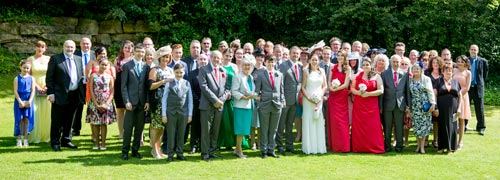 Group photograph of all day guests at the stables wedding