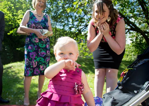 Toddler in a pink dress being watched by her mother and grandma at the Stables in doncaster