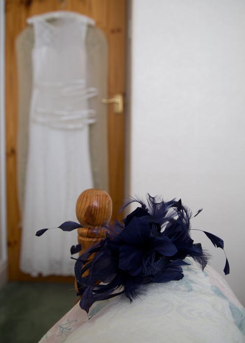 Brides dress and Mother of the brides fascinator in the brides bedroom on the morning of the wedding