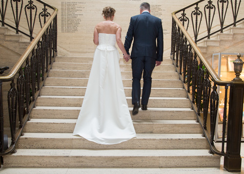 Bride and groom on the steps of Barnlsey Town Hall