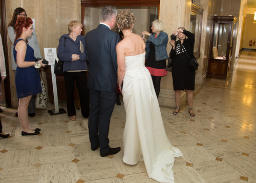 Bride and groom talking to wedding guests at Barnsley Town Hall Wedding