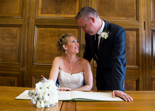 signing the register at Barnsley Town Hall Wedding