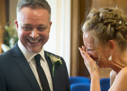 Bride and groom laughing during at Barnsley Town Hall Wedding ceremony