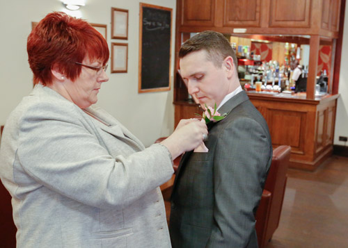 guests fixing grooms buttonhole at wortley hall hotel sheffield