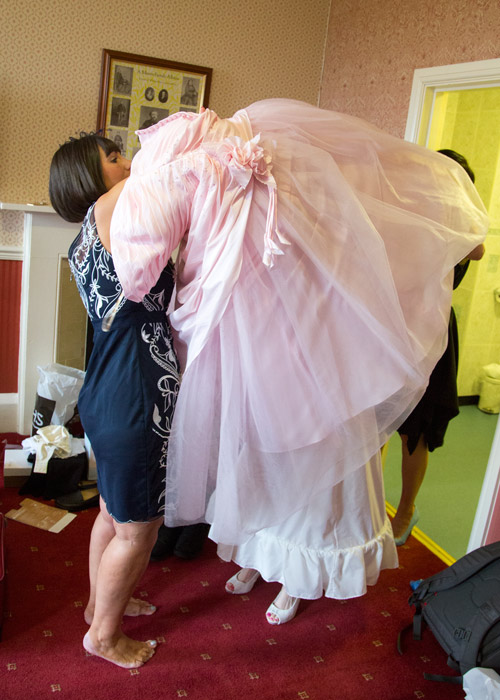 bride putting on her pink wedding dress wortley hall hotel sheffield
