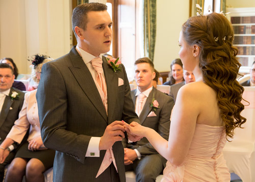 bride and groom exchange rings at wortley hall hotel sheffield