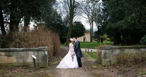 bride and groom kiss in front of wortley hall hotel sheffield