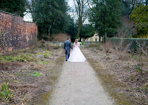 bride and groom walking down path spring wortley hall sheffield
