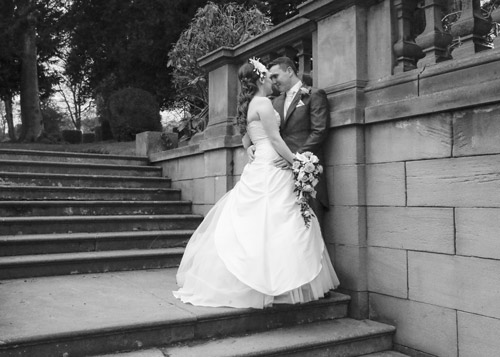 bride and groom pose on steps at wortley hall hotel sheffield