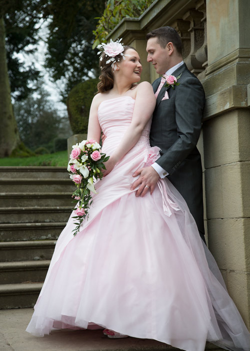 bride and groom on the steps at wortley hall hotel sheffield photogapher