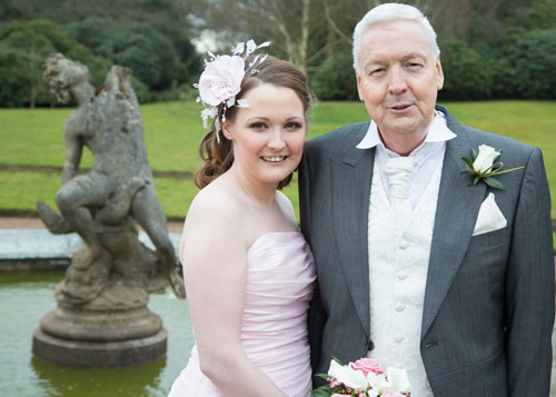 bride and father of the bride next to fountain at wortley hall sheffield