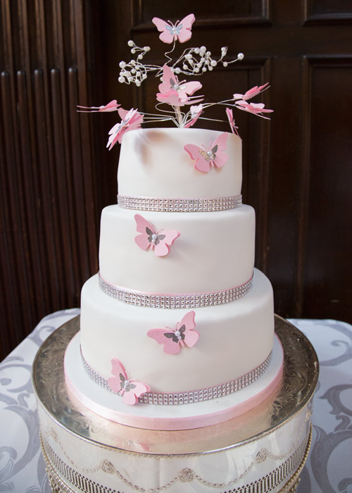 pink and white butterfly wedding cake with diamante embellishment