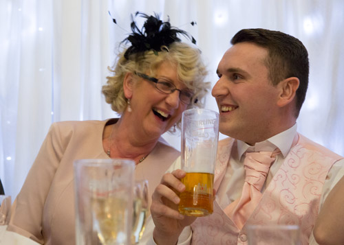groom and mum laughing during the speeches at wortley hall