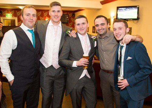 groom and groomsmen during the evening reception art wortley hall photography