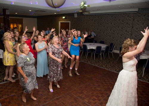 bride throwing her bouquet to the ladies in holiday inn barnsley