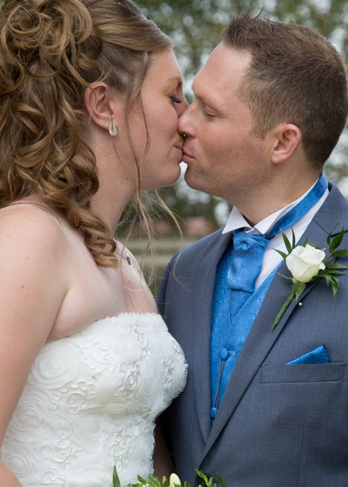 bride and groom kiss in the entrance to the secret garden barnsley potography