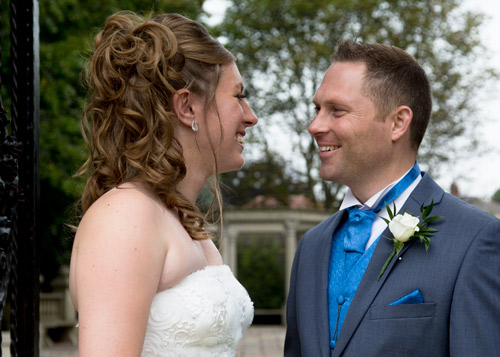 close up of bride and groom in the entrance to the secret garden