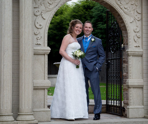 Bride and groom in the entrance to the secret garden