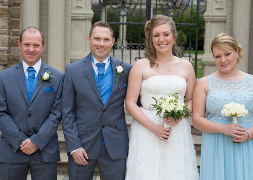 Best man Groom Bride and maid of honor outside the secret garden blue theme wedding
