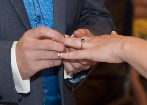 Bride and groom exchanging rings brooklands hotel