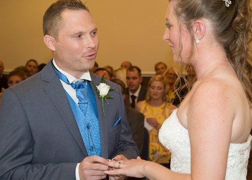 Bride and groom exchanging vows charlotte elizabeth photography