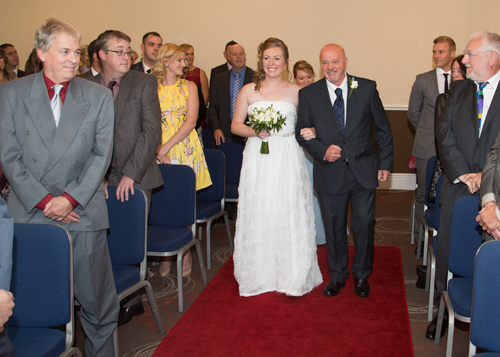 Bride and father of the bride walking down the aisle Holiday Inn Barnsley