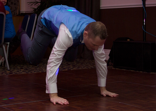 groom breakdancing on an empty dacefloor at his barnsley wedding