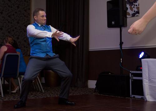 Groom doing a silly first dance move holiday inn barnsley wedding