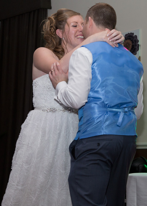 bride smiling at groom during their first dance