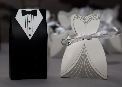 Wedding favours suit and wedding dress
