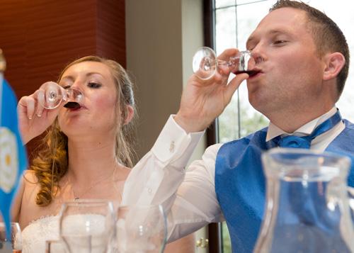 bride and groom drinking a toast at their wedding breakfast in holiday inn barnsley